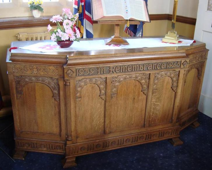 Carved wooden memorial table